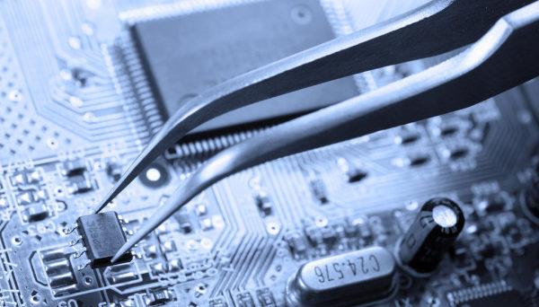 depositphotos_2720130-stock-photo-assembling-a-circuit-board